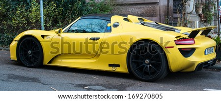 STUTTGART, GERMANY - JANUARY 1, 2014: Porsche 918 Spyder prototype (hybrid using a V8 plus two electronic motors) is parked in the streets of its hometown on January 1, 2014 in Stuttgart, Germany.  - stock photo