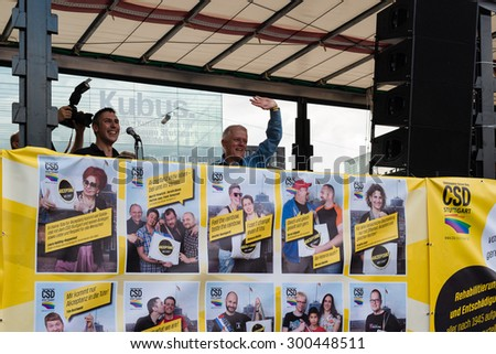 STUTTGART, GERMANY - JULY 25, 2015: Fritz Kuhn,  Lord Mayor of Stuttgart and patron of the Christopher Street Day 2015 in Stuttgart is having a speech as final of the political parade.   - stock photo
