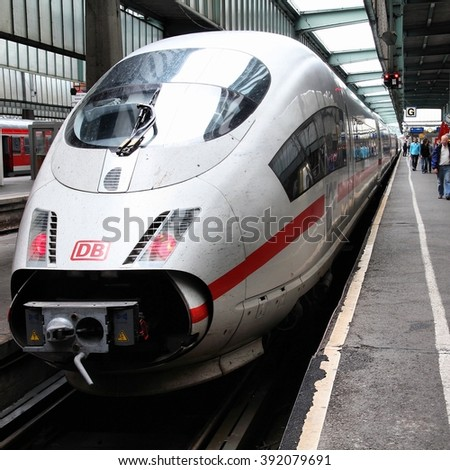 STUTTGART, GERMANY - JULY 24, 2010: Intercity Express (ICE) train of Deutsche Bahn in Stuttgart, Germany. DB took over Arriva Plc company in August 2010. ICE 3 class train manufactured by Siemens.