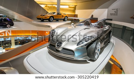 """STUTTGART, GERMANY - JULY 16, 2015: Interior of museum """"Mercedes-Benz Welt"""".Prototype of a futuristic car inside of a museum - stock photo"""