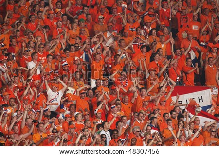 STUTTGART, GERMANY - JUNE 16:  Holland supporters cheer prior to the start of a 2006 FIFA World Cup soccer match between the Netherlands and Cote d'Ivoire June 16, 2006 in Stuttgart, Germany. - stock photo
