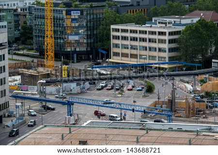 STUTTGART, GERMANY - June 15, 2013: Traffic around construction site at Stuttgart main station (part of S21 project) with long-distance plumbing moved over ground on June 15, 2013 in Stuttgart,Germany