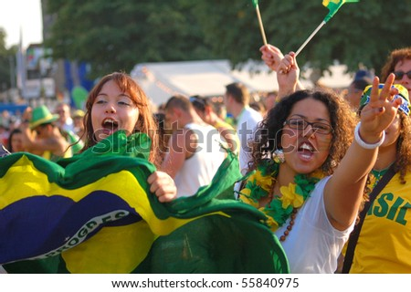 STUTTGART, GERMANY - JUNE 17: Worldcup fans celebrating their teams victory at a FIFA fan gathering in Stuttgart, Germany on June 17th 2006 - stock photo
