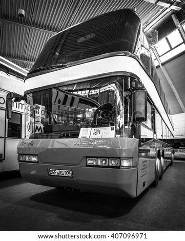 "STUTTGART, GERMANY - MARCH 18, 2016: Bus NEOPLAN 128/4 Megaliner, 1993. Black and white. Europe's greatest classic car exhibition ""RETRO CLASSICS"""