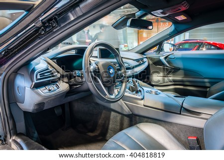 "STUTTGART, GERMANY - MARCH 17, 2016: Cabin of a plug-in hybrid sports car BMW i8. HDRi. Europe's greatest classic car exhibition ""RETRO CLASSICS"""