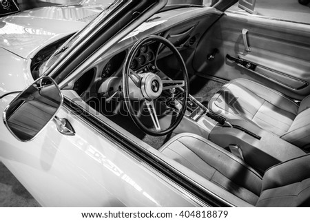 "STUTTGART, GERMANY - MARCH 17, 2016: Cabin of sports car Chevrolet Corvette Stingray Coupe (C3), 1975. Black and white. Europe's greatest classic car exhibition ""RETRO CLASSICS"" - stock photo"