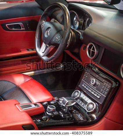 "STUTTGART, GERMANY - MARCH 18, 2016: Cabin of supercar Mercedes-Benz SLS AMG (R197), 2012. Europe's greatest classic car exhibition ""RETRO CLASSICS"" - stock photo"