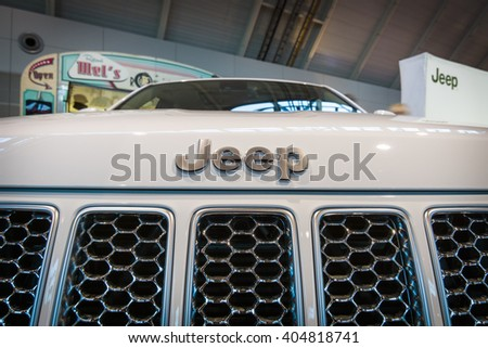 "STUTTGART, GERMANY - MARCH 17, 2016: Detail of mid-size luxury crossover SUV Jeep Grand Cherokee, 2015. Europe's greatest classic car exhibition ""RETRO CLASSICS"" - stock photo"
