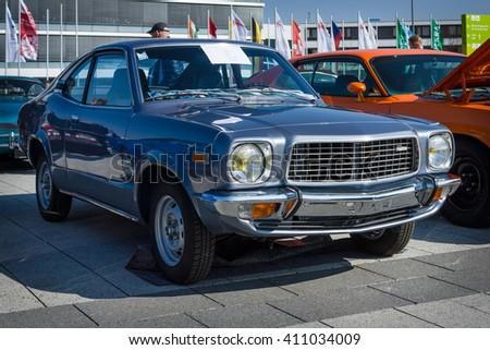 """STUTTGART, GERMANY - MARCH 18, 2016: Mid-size car Mazda Grand Familia (Mazda 818 Coupe De Luxe), 1976. Europe's greatest classic car exhibition """"RETRO CLASSICS"""" - stock photo"""