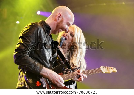 STUTTGART, GERMANY - MARCH 24: Singer Bonnie Tyler and guitarist live in concert on stage at the festival March 24, 2012 in Stuttgart, Germany - stock photo