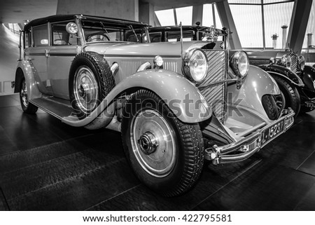 STUTTGART, GERMANY- MARCH 19, 2016: The car of the former German Emperor Wilhelm II, Mercedes-Benz 770 Grand Mercedes convertible F, 1932. Black and white. Mercedes-Benz Museum. - stock photo