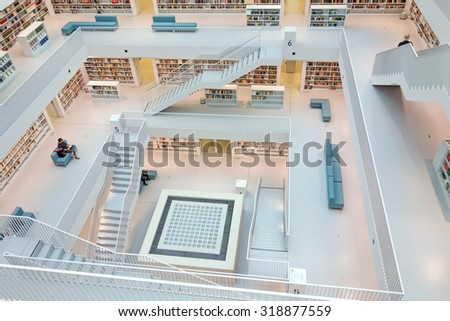 Stuttgart, Germany - March 17, 2014: The Stuttgart City Library designed by Eun, Young, Yi. It provides more than 500.000 books. View from the top level into the upper hall. - stock photo