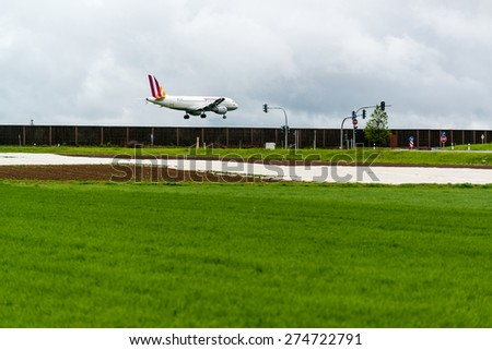 STUTTGART, GERMANY- MAY 03, 2015: A Germanwings Airbus A319-100 airplane is approaching Stuttgart Airport in Germany. Germanwings is a German a low-cost airline wholly owned by Lufthansa.  - stock photo