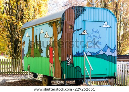 Stuttgart, Germany - November 08,2014: The forest Kindergarten Widmaierstrasse uses an old trailer previously used as contractor's shed to educate small children outdoors on November 08, 2014 in - stock photo