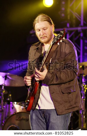 STUTTGART - JULY 05: Derek Trucks & Tedeschi Trucks Band in concert at Jazzopen Stuttgart July 05, 2011 in Stuttgart, Germany - stock photo