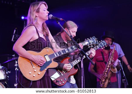 "STUTTGART - JULY 05: Group ""Tedeschi Trucks Band"" in concert at Jazzopen Stuttgart July 05, 2011 in Stuttgart, Germany - stock photo"