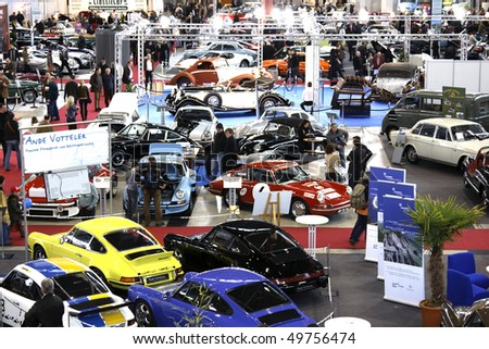 STUTTGART - MARCH 13: People buy cars - exhibition hall Retro Classics March 13, 2010 in Stuttgart, Germany. - stock photo