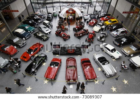 STUTTGART - MARCH 13: People buy cars - exhibition hall Retro Classics March 13, 2011 in Stuttgart, Germany. - stock photo