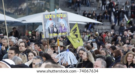 STUTTGART - MARCH 27: People cheer about changing the policy in Stuttgart. March 27, 2011 in Stuttgart, Germany