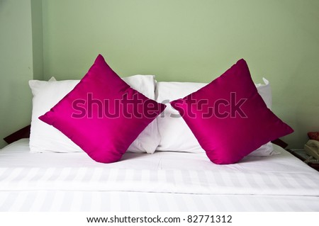 style bedroom interior with double pink  pillows on green back ground - stock photo