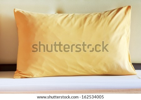 style bedroom interior with  yellow pillows. - stock photo