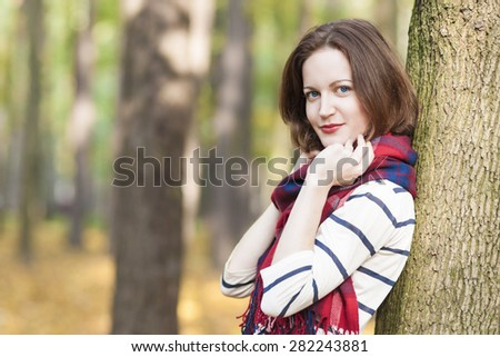 Style Concept: Caucasian Female Model Dressed in Stylish Clothing. Standing Outdoors in Forest. Horizontal Image Orientation - stock photo