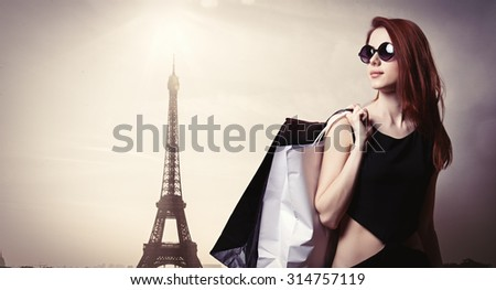 Style girl with shopping bags on parisian background - stock photo