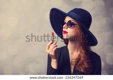 Style redhead women with sunglasses and lipstick. - stock photo
