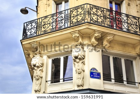 Styled corner of the building in the  5th arrondissement of Paris - ancient mouldings and wrought iron balcony. - stock photo