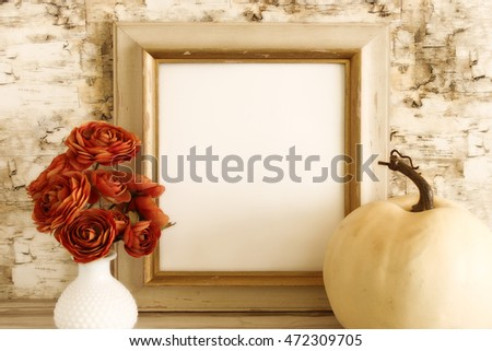 Styled fall vignette with natural elements vintage frame with blank space for text