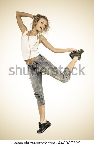 Styled portrait of young dancing girl on a white background