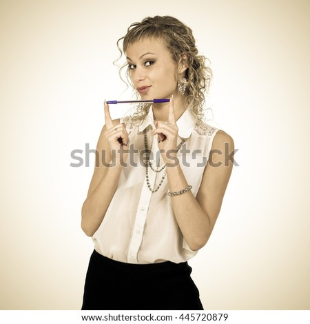 Styled portrait of young student girl with pen on white - stock photo