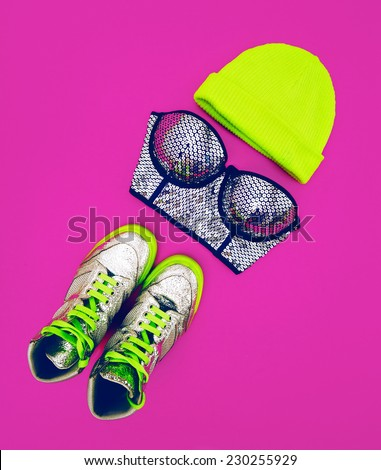 Stylish Accessories glamorous Lady. Set to the party: fashion Sneakers, Bra and Hat - stock photo