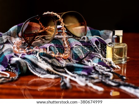 Stylish accessories. sunglasses, perfume and scarf - stock photo