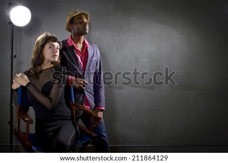 stylish actors posing on a concrete background with pompous expression - stock photo
