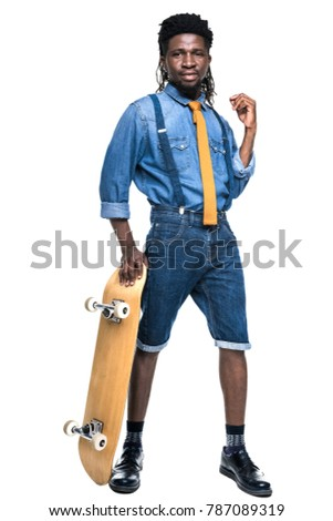 stylish african american man standing with skateboard isolated on white