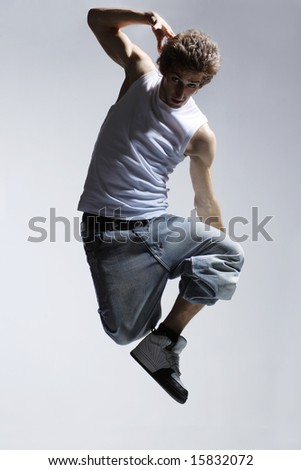stylish and cool breakdancer jumping - stock photo