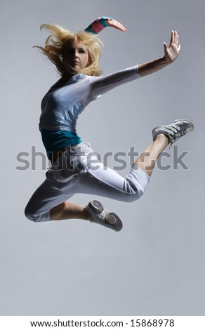 stylish and cool looking breakdancer jumping - stock photo