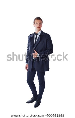 Stylish and handsome man in deep blue color of clothes. Full-length. Isolated on white background.