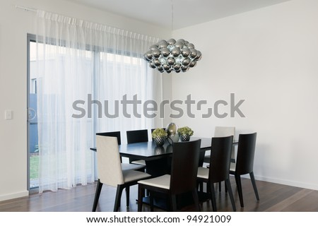 Stylish area with table and chairs - stock photo