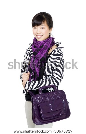 Stylish asian girl with purple bag and scarf looking to camera - stock photo