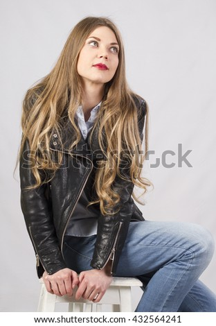 stylish attractive girl with long beautiful hair in studio