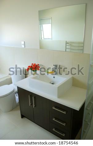 stylish bathroom interior with mirror - stock photo