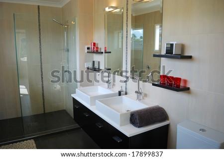 stylish bathroom interior with mirror and decoration - stock photo
