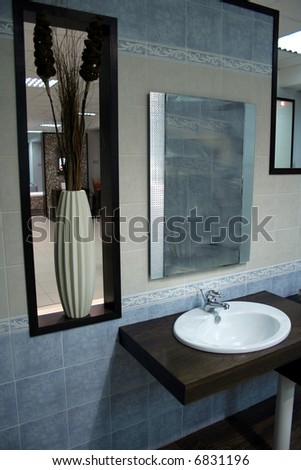 Stylish bathroom sink in an interior space - stock photo