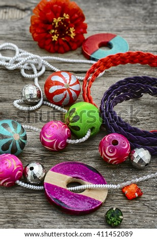 Stylish beads and jewelry strung on the chain - stock photo