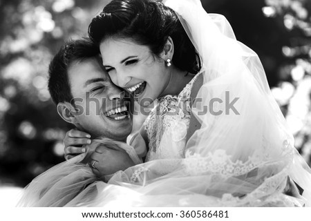 Stylish beautiful couple of happy newlyweds on a walk in San Diego on their wedding day, close up portrait - stock photo