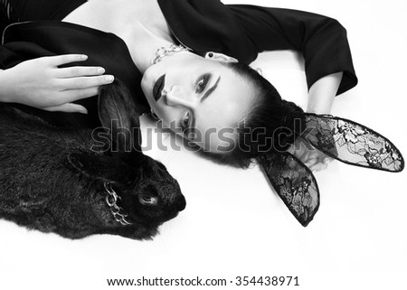 Stylish, beautiful girl model in an image of a rabbit - stock photo