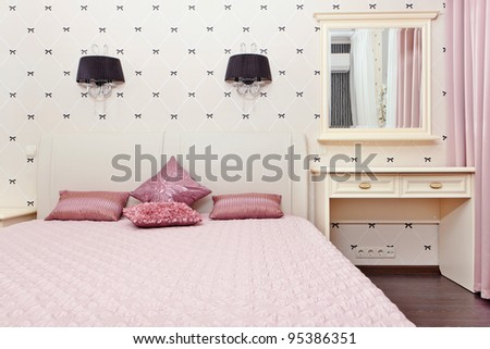 Stylish bedroom interior with double bed - stock photo