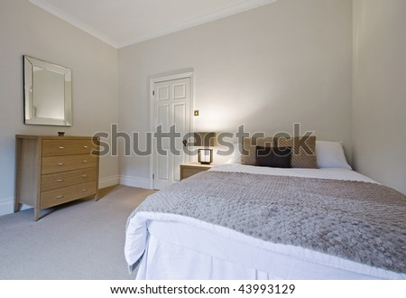 stylish bedroom with double bed and modern furniture
